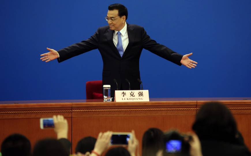 China vows to press on with economic reforms despite pain for some