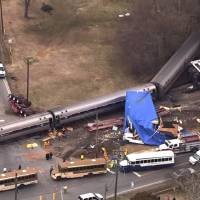 Passenger train derails in collision with truck in North Carolina; several hurt