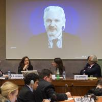Julian Assange, founder of WikiLeaks, speaks on a webcast from his asylum at the Ecuadorian Embassy in London during a conference of Western persecution at the European headquarters of the United Nations in Geneva, Monday. | AP