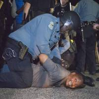 Quick answers to double shooting elude police in Ferguson