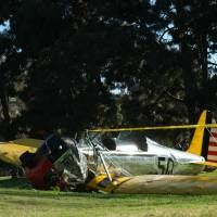 The small plane owned by U.S. actor Harrison Ford is seen after crashing at the Penmar Golf Course in Venice, California. 'Indiana Jones' actor Ford was injured in the Thursday crash, the TMZ celebrity news website reported.  The 72-year-old suffered multiple gashes to his head and was left bleeding after the crash of the vintage two-seater. | AFP-JIJI