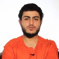 An image grab taken Tuesday from a video reportedly released by the Islamic State group through Al-Furqan Media, one of the Jihadist platforms used by the militant organization on the Web, shows a youth identifying himself as 19-year-old Mohammed Said Ismail Musallam, from Jerusalem, wearing an orange jumpsuit as he addresses the camera in Arabic at an undisclosed location. Islamic State released the video purportedly showing Musallam being executed by a young boy after he allegedly infiltrated the group in Syria to spy for the Jewish state. | AL-FURQAN MEDIA / HO / AFP-JIJI