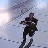 Washington state kidnapper caught on video running with toddler