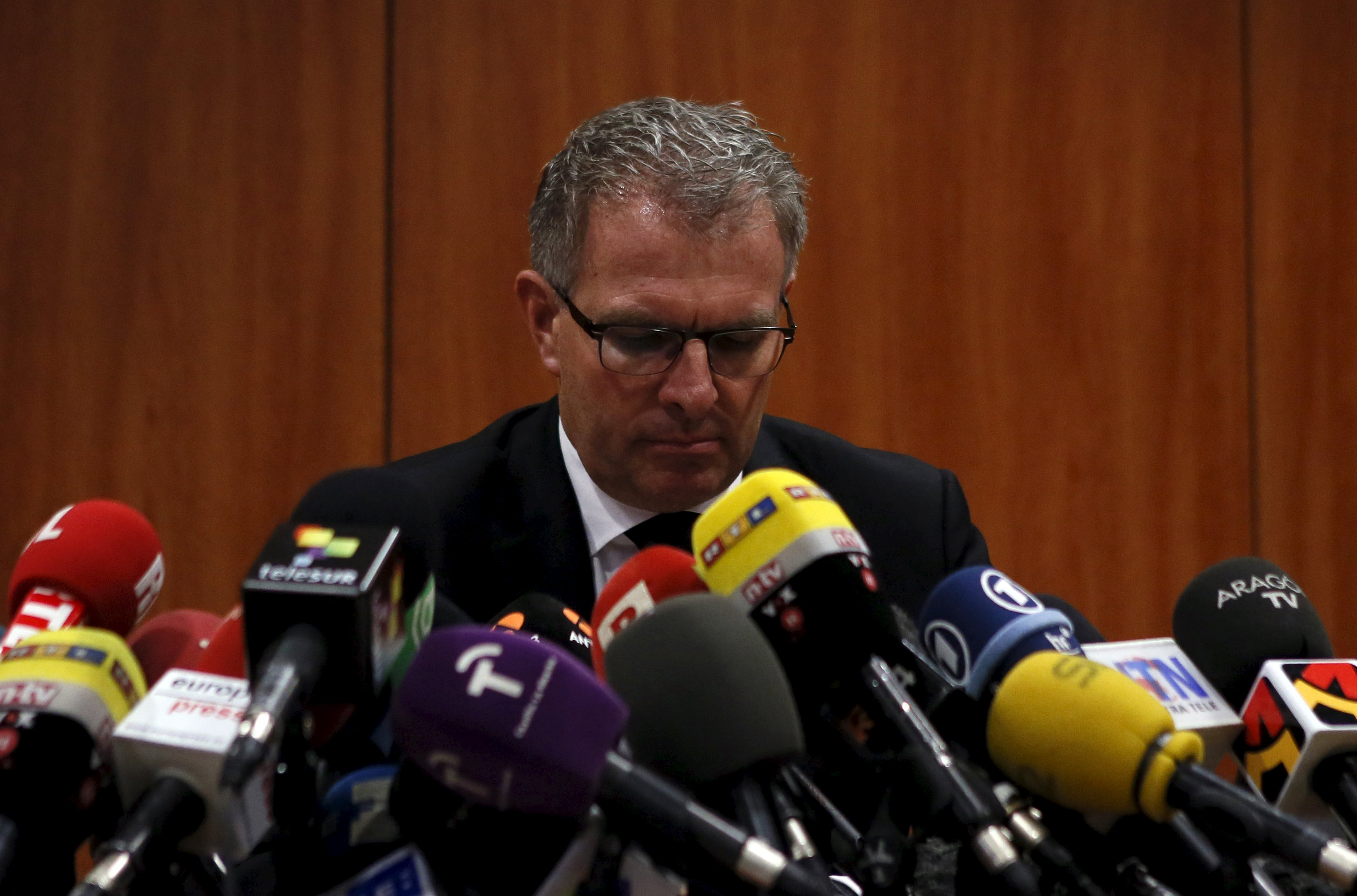 Lufthansa Chief Executive Carsten Spohr reacts during a news conference at Barcelona's El Prat airport Wednesday. Investigators have extracted cockpit voice recordings from one of the black boxes of the Germanwings Airbus plane that smashed into the Alps and expect to have a read-out of their content within days, an official said on Wednesday. The New York Times meanwhile reported that there are sound indications that one of the pilots was locked out of the cockpit, desperately trying to get back in, when the jet went down. | REUTERS