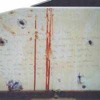 A bloodstained message that prosecutors say Boston Marathon bombing suspect Dzhokhar Tsarnaev wrote on the inside of a boat is seen with bullet holes in an undated evidence picture shown to jurors in Boston on Tuesday. Tsarnaev, 21, is accused of killing three people and injuring 264 with a pair of homemade bombs at the race's crowded finish line on April 15, 2013, as well as fatally shooting a police officer three days later as he and his brother, Tamerlan Tsarnaev, tried to flee the city. | REUTERS