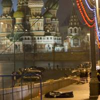 The body of Boris Nemtsov, a former Russian deputy prime minister and opposition leader, lies in Moscow's Red Square with St. Basil's Cathedral in the background on Saturday after he was gunned down near the Kremlin. | AP