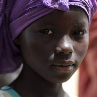 A Nigerian refugee girl is seen at a Chadian gendarmerie camp in the village of Klissoum near N'Djamena on Saturday. Two months after neighboring countries sent troops to help crush the ruthless Islamist movement Boko Haram inside Nigeria, there is frustration at the lack of cooperation from the Nigerian authorities. | AFP-JIJI