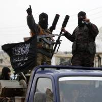 Members of al-Qaida's Nusra Front drive in a convoy through one of the villages that they claimed to have seized from Syrian rebel factions in the southern countryside of Idlib last December. | REUTERS