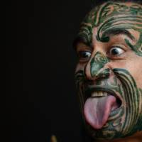 Wetini Mitai makes a Maori grimace at the 63rd Frankfurt Book Fair in October 2012. New Zealand has been settling with some Maori groups for past wrongs, in an effort to salve grievances. | AFP-JIJI