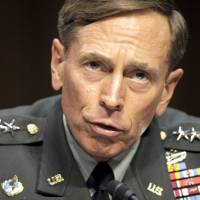 CIA Director nominee Gen. David Petraeus testifies on Capitol Hill in June 2011 before the Senate Intelligence Committee during a hearing on his nomination. The Justice Department said Tuesday that the former top Army general has agreed to plead guilty to mishandling classified materials. A statement from the agency says a plea agreement has been filed in U.S. District Court in Charlotte, North Carolina, the hometown of Paula Broadwell, the general's biographer and former mistress. | AP
