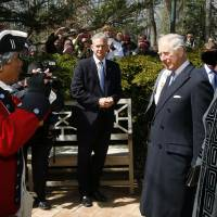 Fifer Dan Francisco plays 'God Save the Queen' for Britain's Prince Charles and Camilla, the Duchess of Cornwall, during their visit to Mount Vernon, the home of George Washington, Wednesday, in Mt. Vernon, Virginia. | AP