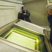 Britain's Prince Charles looks at the Declaration of Independence during a visit to the National Archives in Washington on Wednesday. | AP