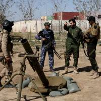 Kurds report more chlorine attacks; Iraq pauses Tikrit offensive