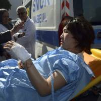 A victim arrives at the Charles Nicoles hospital, Wednesday in Tunis. Authorities say scores of people are dead after an attack on a major museum in the Tunisian capital, and some of the gunmen may have escaped. | AP