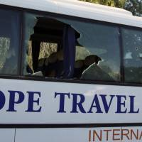 A damaged bus is seen after an attack by gunmen on foreign tourists at Tunisia's national museum in Tunis Wednesday. | REUTERS