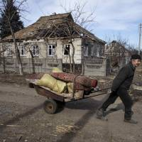 A ruined house in town of Debaltseve on Wednesday, which was besieged by pro-Russian rebels until Ukrainian government troops pulled out. The U.S. State Department called the rebels' actions, during a supposed cease-fire, a 'land grab.'   REUTERS