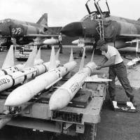 U.S. Air Force personnel prepare AIM-7 missiles for loading on F-4C Phantoms in South Vietnam in 1967. The plane served at Cam Ranh Air Base. The aircraft on the right crashed in Laos on 22 March 1968 following a bomb malfunction over Khe Sanh. One crew member was captured, the other was missing.   CC-BY-SA 2.0