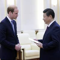 Setting aside rancor over Hong Kong, China welcomes Britain's Prince William