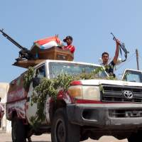 Militants loyal to Yemen's President Abd Rabbu Mansour Hadi man a checkpoint on a street Monday in the country's southern port city of Aden. Iran-allied Houthi militiamen pushed into the northeastern outskirts of Aden on Monday amid heavy clashes with loyalists of Hadi apparently backed by Saudi-led airstrikes.   REUTERS