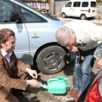 MTV3 correspondent Petri Saraste attempts to transfer gasoline from a Toyota in a parking lot just west of disaster-hit Sendai.