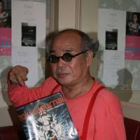 Below: Photographer Nobuyoshi Araki poses with a copy of Tokyo Journal. | C.B. LIDDELL