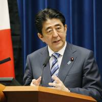 Prime Minister Shinzo Abe holds a news conference at his office Tuesday on the eve of the fourth anniversary of the March 11, 2011 disasters. | KYODO