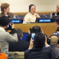 Shoko Kanazawa, a Japanese calligrapher with Down syndrome, speaks at United Nations headquarters in New York on Friday. The U.N. designates every March 21 as World Down Syndrome Day. | KYODO