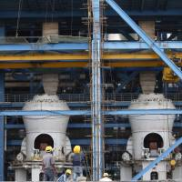 Boilers are seen at a coal-fired power plant being built in Kudgi, India, at the end of February. The project is being partially financed by the Japan Bank for International Cooperation. | AP