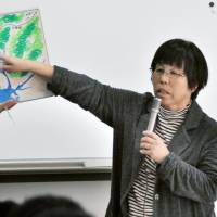 Mari Tamba, whose father was exposed to radiation from the atomic bombing of Hiroshima in August 1945, speaks at a high school in Nagoya last November about eliminating nuclear weapons. | KYODO