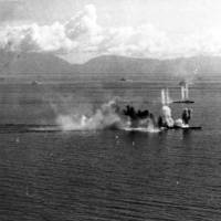 U.S. warplanes attack the Musashi in October 1944, in the Sibuyan Sea of the Philippines. The battleship sank after being hit by an estimated 20 to 30 torpedoes and 17 bombs from enemy aircraft. | ROBERT L. LAWSON PHOTOGRAPH COLLECTION/U.S. NAVY NATIONAL MUSEUM OF AVIATION
