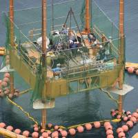 Okinawa Defense Bureau workers resume a boring survey needed for construction of the U.S. replacement airfield for Futenma, in waters off Henoko in Okinawa Prefecture, on Thursday. | KYODO