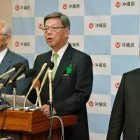 Okinawa Gov. Takeshi Onaga speaks during a news conference Monday in Naha. | KYODO