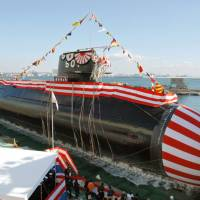 Soyu, Japan's ultraquiet high-tech submarine, is unveiled at a ceremony at a Mitsubishi Heavy Industries dock in Kobe in 2007. Indian Defense Minister Manohar Parrikar has expressed his interest in acquiring the diesel-electric Soryu-class submarines from Japan. | KYODO
