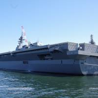 The Izumo 'helicopter destroyer' is docked in Yokohama on Wednesday after a ceremony in which shipbuilder Japan Marine United Corp. handed the 19,500 ton-warship over to the Maritime Self-Defense Force. | REIJI YOSHIDA
