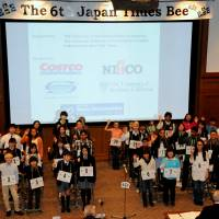 Sean Fogerty (center), the 13-year-old winner of the 6th Japan Times Bee, poses with (from left) spelling judge Steve McClure, master of ceremonies Marc Davies, The Japan Times President Takeharu Tsutsumi, spelling judge Teru Clavell, pronouncer James Tschudy and The Japan Times Managing Editor Edan Corkill. | SATOKO KAWASAKI