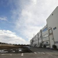 A vacant lot and commercial building owned by auto-parts maker Murata Spring Co. stands in an industrial park on the old site of a Panasonic Corp. factory in Utsunomiya, Tochigi Prefecture, on Feb. 13. | BLOOMBERG