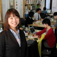 Kumi Imamura, head of NPO Katariba, poses in her office in Suginami Ward, Tokyo, on Feb. 19. | SATOKO KAWASAKI