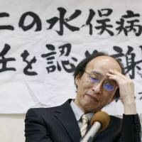Attorney Akira Takashima expresses disappointment at a news conference following Monday's Niigata District Court decision that the central government and Niigata Prefectural Government were not responsible for neurological disorders caused by pollution. | KYODO