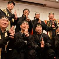 Former Tourism Agency chief Hiroshi Mizohata (first row, right) joins governors and mayors from Mie, Shiga and Kanagawa prefectures in dressing up as ninja Sunday to announce the launch of the Ninja Council to promote tourism to Japan. | AFP-JIJI
