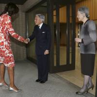 U.S. first lady Michelle Obama is greeted by Emperor Akihito and Empress Michiko upon her arrival at the Imperial Palace in Tokyo on Thursday. | AP