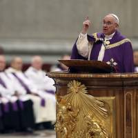 Pope Francis speaks at St. Peter's Basilica in the Vatican on March 13.   REUTERS/KYODO