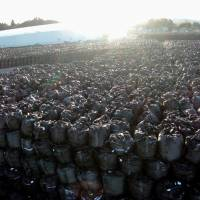 Bags of radioactive waste are seen piled up at a temporary storage site in Tomioka, Fukushima Prefecture, on Wednesday. Four years after the nuclear disaster began, a final disposal site for tainted debris it created has yet to be designated. | KYODO