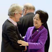 Disaster management minister Eriko Yamatani and Margareta Wahlstroem, the U.N. secretary general's special representative for disaster risk reduction, congratulate each after the U.N. conference in Sendai wrapped up Thursday. | KYODO