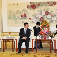 Chinese official says ties with Japan heading in good direction