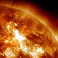 A solar flare erupts on the Sun's northeastern hemisphere during a powerful solar storm in January 2012. Japanese scientists have succeeded in transmitting energy wirelessly, a key step that could one day make solar power generation in space a possibility, an official said this week. | NASA / AP