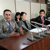 Syrian Joude Youssef (left) pleads for refugee status in Tokyo on Tuesday. He is one of four asylum seekers who arrived in 2012 and are now suing the government over their rejected applications. | TOMOHIRO OSAKI