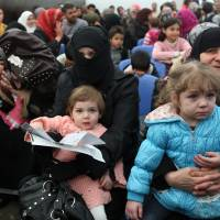 Four Syrian asylum seekers to sue for refugee status