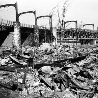 This composite shows the initial destruction and reconstruction after the March 10, 1945 firebombing.  The top photo, taken on March 19, 1945, shows an incendiary bomb-devastated area and Sumidagawa Bridge after  theTokyo firebombing. The bottom photo, taken 70 years later on March 7, 2015, shows trains run over Sumidagawa Bridge with Tokyo Skytree in distance. | AP/THE CENTER OF THE TOKYO RAIDS AND WAR DAMAGE, EUGENE HOSHIKO