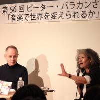 Writer Keiko Ochiai and British-born broadcaster Peter Barakan talk at a workshop against nuclear power in Tokyo on Feb. 28. | KYODO