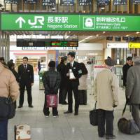 Commuters in Nagano Station await for train service to resume Monday morning after a massive power outage snarled transportation in the capital of Nagano Prefecture for close to three hours.  | KYODO